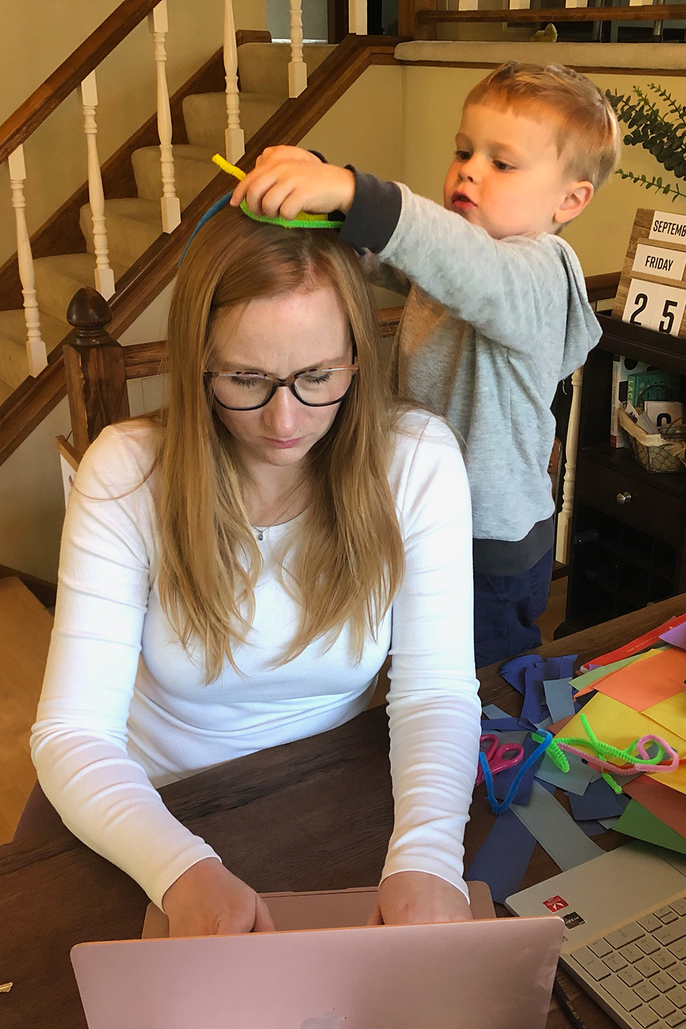 Mom trying to work at home - Managing Your Mental Health While Parenting in a Pandemic
