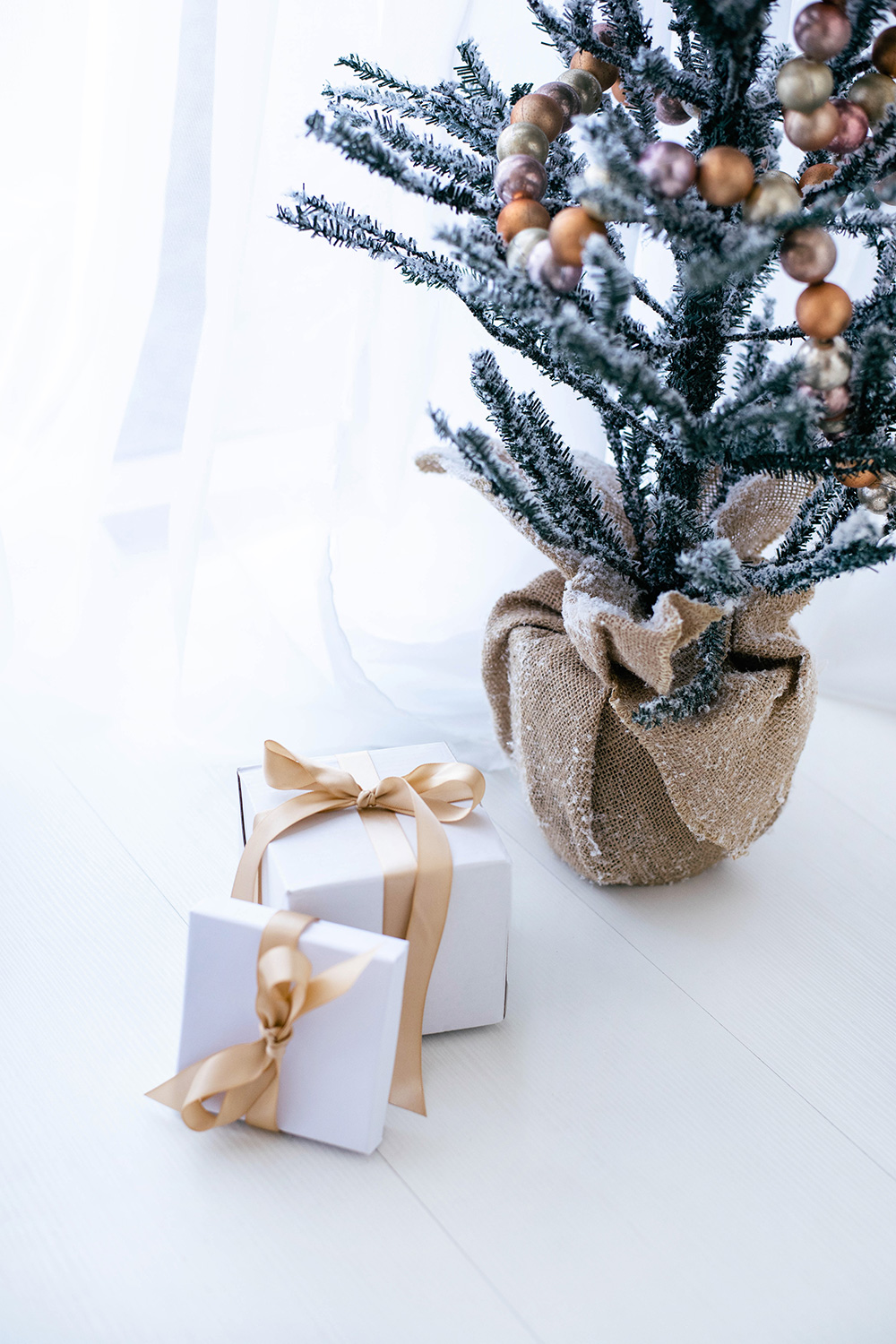 holiday tree and presents - Embracing the JOMO (The Joy of Missing Out) this Holiday Season